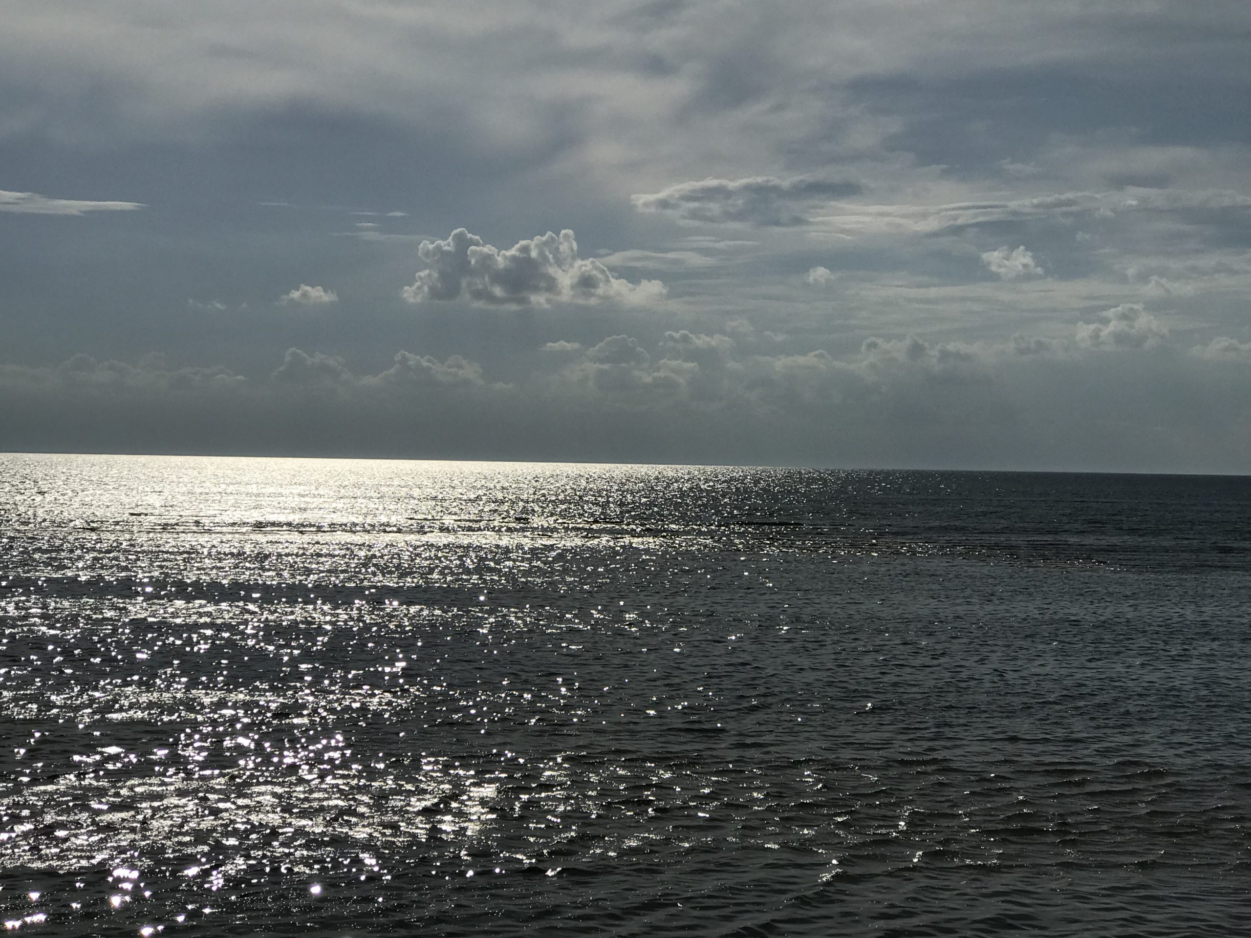 big waterviews with sparkling siver water with clouds 2019